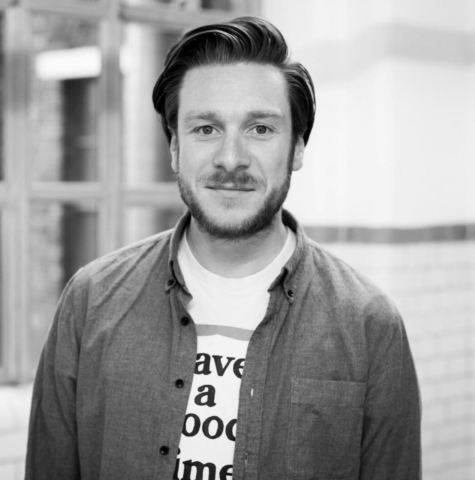 A headshot of Ben Harwood - creative director at Feed agency